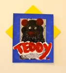 teddy <3s you, acrylic on photograph and found cardboard