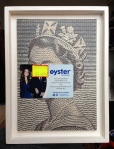 trophy head, Oyster card and reduced price label on a blown up print of a bank note (not available)